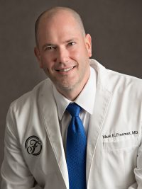 Dr. Mark E. Freeman